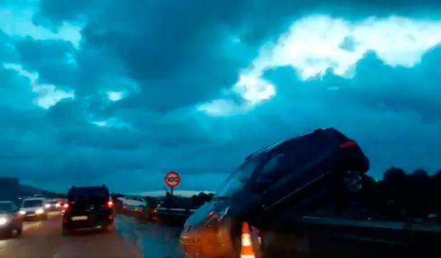 Flash floods: Still from video by Controladores Aereos of abandoned damaged vehicles on the road in Majorca. Picture: PA