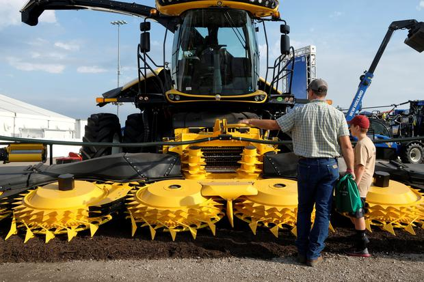 Dan Strieggl and his son Issac inspect new farm equipment at the 2018 Farm Progress Show in Boone, Iowa, U.S., August 28, 2018. Picture taken on August 28, 2018. REUTERS/Jordan Gale