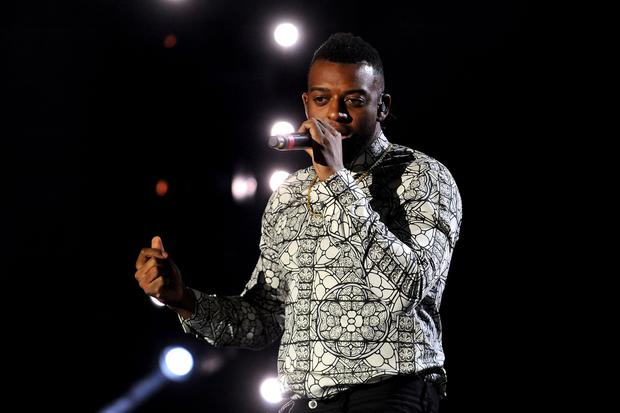 Williams on stage during his JLS career (PA)