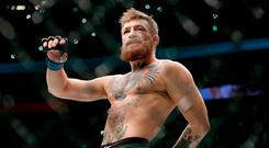 Conor McGregor walks in the cage before fighting Khabib Nurmagomedov in a lightweight title mixed martial arts bout at UFC 229