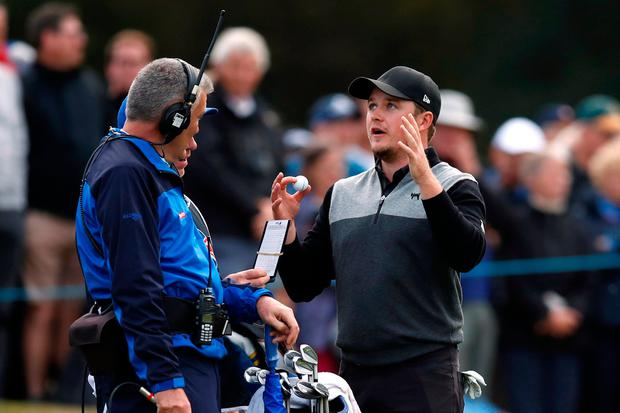 Eddie Pepperell reacts after making a hole in one during the first round