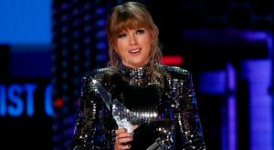 Taylor Swift took the opportunity to rally her fans to vote after accepting a gong at the American Music Awards. Photo: REUTERS/Mario Anzuoni