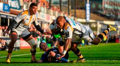 Changing times: Sailosi Tagicakibau casts aside Johnny Sexton during Wasps' victory over Leinster in 2015, but a lot has changed since. Photo: Ramsey Cardy/SPORTSFILE
