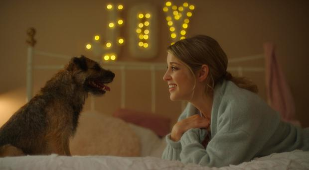 Shaggy-dog tale: Huberman with her furry co-star in Finding Joy