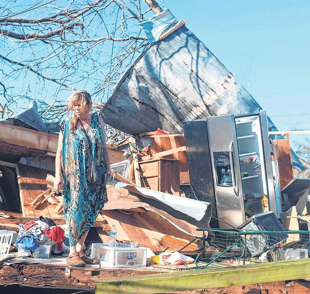Kathy Coy stands among what is left of her home after Hurricane Michael hit Panama City, Florida. Photo: Joe Raedle/Getty