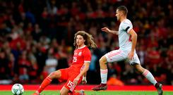 Wales' Ethan Ampadu (left) and Spain's Dani Ceballos battle for the ball. Photo: Nick Potts/PA Wire