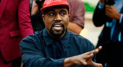 122c4bf1 Rapper Kanye West speaks during a meeting in the Oval Office of the White  House with