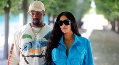 762bfccc Kanye West and Kim Kardashian attend the Louis Vuitton Menswear  Spring/Summer 2019 show as
