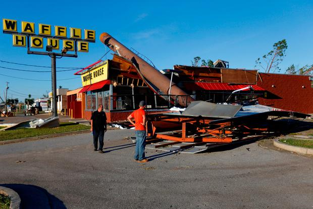 People inspect a Waffle House damaged by Hurricane Michael in Callaway, Florida, U.S. October 11, 2018. REUTERS/Jonathan Bachman