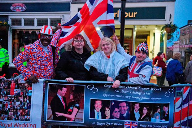 Royal fans in Windsor ahead of the wedding of Princess Eugenie to Jack Brooksbank at St George's Chapel in Windsor Castle. PRESS ASSOCIATION Photo. Picture date: Friday October 12, 2018. See PA story ROYAL Wedding. Photo credit should read: Kirsty O'Connor/PA Wire
