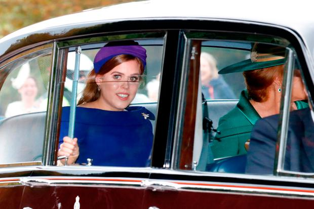 Princess Beatrice of York and her mother Sarah Ferguson (R) arrive in their car to the Royal wedding of Princess Eugenie of York and Mr. Jack Brooksbank at St. George's Chapel on October 12, 2018 in Windsor, England. (Photo by Chris Jackson/Getty Images)