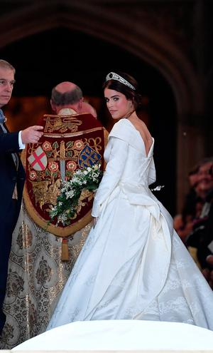 Britain's Princess Eugenie enters St George's Chapel with her father Prince Andrew, Duke of York, for her wedding to Jack Brooksbank in Windsor Castle, Windsor, Britain October 12, 2018. REUTERS/Toby Melville
