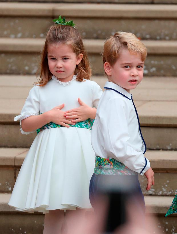 Princess Charlotte and Prince George arrive for the wedding of Princess Eugenie to Jack Brooksbank at St George's Chapel in Windsor Castle