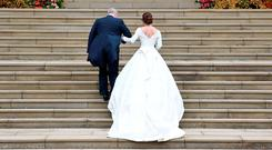 Britain's Princess Eugenie arrives accompanied by her father Prince Andrew, Duke of York, at St George's Chapel for her wedding to Jack Brooksbank in Windsor Castle, Windsor, Britain October 12, 2018. REUTERS/Toby Melville