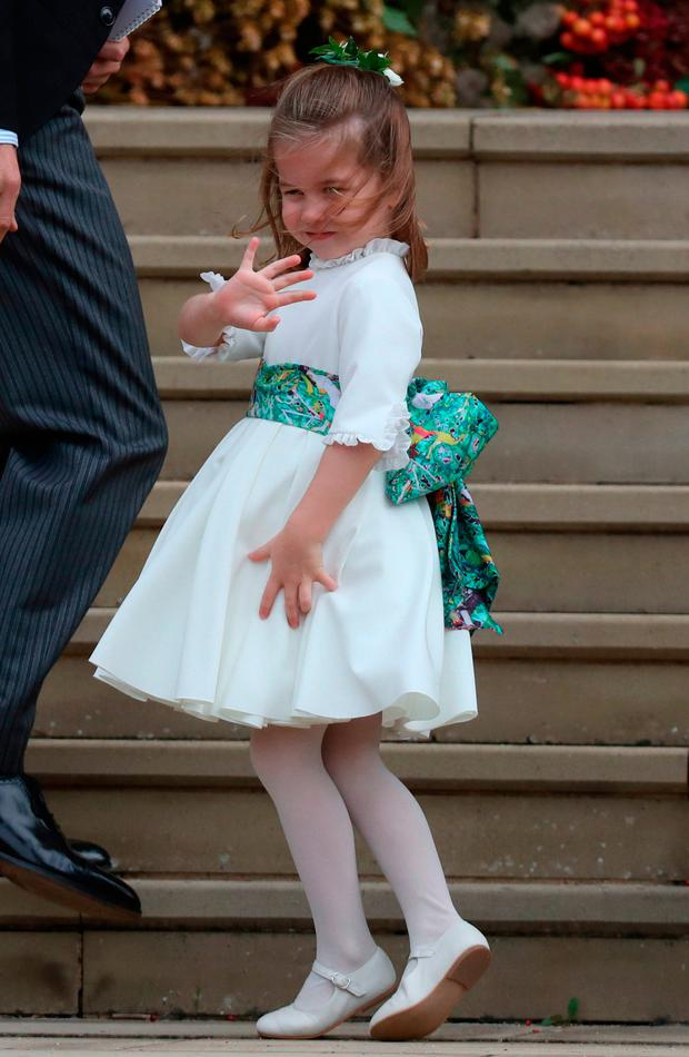 Princess Charlotte arrives for the wedding of Princess Eugenie to Jack Brooksbank at St George's Chapel in Windsor Castle