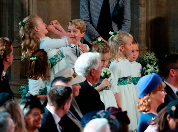 The bridesmaids and page boys, inclduing Prince George and Princess Charlotte, arrive for the wedding of Princess Eugenie to Jack Brooksbank at St George's Chapel in Windsor Castle