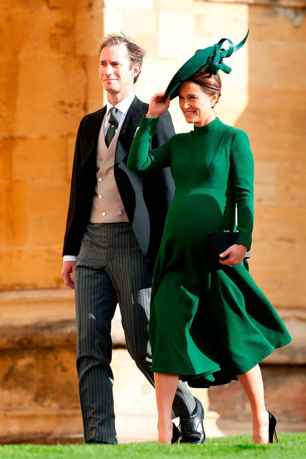 Pippa Matthews and her husband James Matthews arrive for the wedding of Princess Eugenie to Jack Brooksbank at St George's Chapel in Windsor Castle