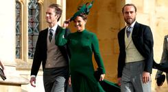 Philippa Matthews (Middleton) (C), James Middleton (CR), the siblings of Britain's Catherine, Duchess of Cambridge, and Pippa's husband James Matthews (CL) arrive to attend the wedding of Britain's Princess Eugenie of York to Jack Brooksbank at St George's Chapel, Windsor Castle, in Windsor, Britain October 12, 2018. Adrian Dennis/Pool via REUTERS