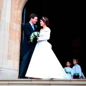 Princess Eugenie and her new husband Jack Brooksbank leave St George's Chapel in Windsor Castle following their wedding