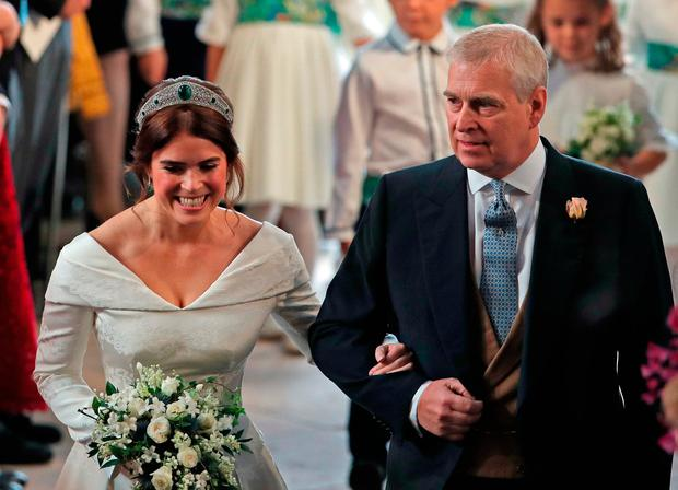 Princess Eugenie walks down the aisle with her father, the Duke of York, for her wedding to Jack Brooksbank at St George's Chapel in Windsor Castle
