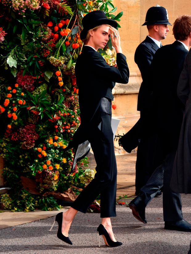 Cara Delevingne after the wedding of Princess Eugenie to Jack Brooksbank at St George's Chapel in Windsor Castle