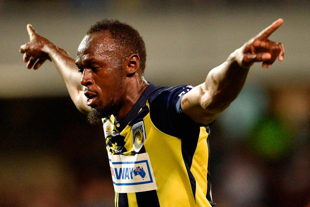 Olympic sprinter Usain Bolt celebrates scoring a goal for A-League football club Central Coast Mariners in his first competitive start for the club against Macarthur South West United in Sydney