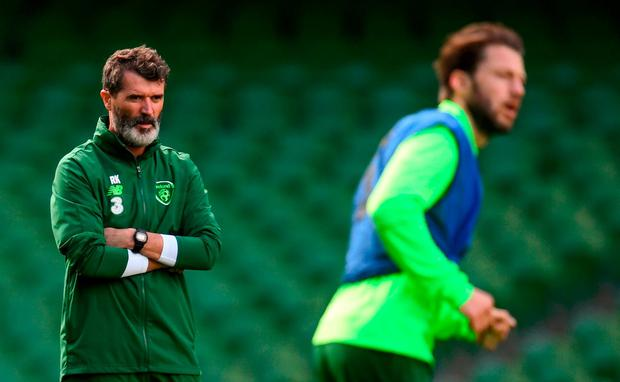 Republic of Ireland assistant manager Roy Keane, left, and Harry Arter during a Republic of Ireland training session at the Aviva Stadium in Dublin. Photo by Stephen McCarthy/Sportsfile
