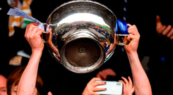 Scotstown captain Darren Hughes lifts the Duffy Cup after the Monaghan SFC final, one of few to be played despite the inter-county season being finished earlier than normal. Photo: Philip Fitzpatrick/Sportsfile