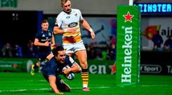 James Lowe of Leinster dives over to score his side's third try during the Heineken Champions Cup Pool 1 Round 1 match between Leinster and Wasps at the RDS Arena in Dublin. Photo by Ramsey Cardy/Sportsfile