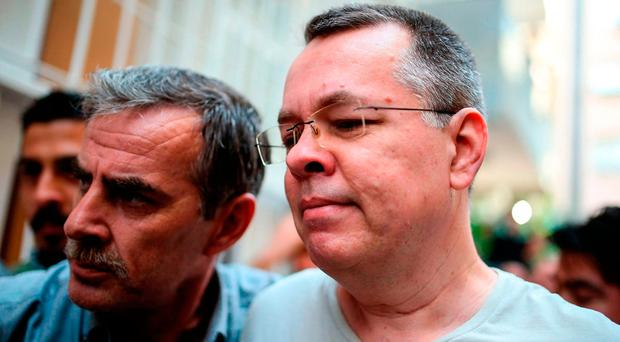 Pastor convicted in terrorism spying trial told he is free to go