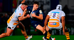 Leinster's Garry Ringrose is tackled by Kieran Brookes, left, and Nizaam Carr of Wasps. Photo: Ramsey Cardy/Sportsfile