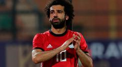 Egypt's Mohamed Salah applauds fans as he leaves the pitch due to injury