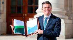 Finance Minister Paschal Donohoe outside Government Buildings before he unveiled his Budget 2019. Photo: Niall Carson/PA