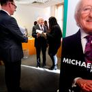 Planning ahead: President Michael D Higgins consults a member of his staff at his campaign office in Dublin as he prepares his bid for a further seven years in Aras an Uachtarain. Photo: David Conachy