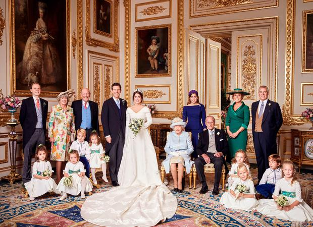Happy couple: The official wedding photograph of Princess Eugenie and Jack Brooksbank in the White Drawing Room, Windsor Castle, with (left to right) Back row: Thomas Brooksbank; Nicola Brooksbank; George Brooksbank; Princess Beatrice of York; Sarah, Duchess of York; The Duke of York. Middle row: Prince George and Princess Charlotte of Cambridge; The Queen; The Duke of Edinburgh; Maud Windsor; Louis De Givenchy; Front row: Theodora Williams; Mia Tindall; Isla Phillips and Savannah Phillips. Photo: Alex Bramall/PA Wire