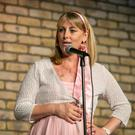 HUMOUR AND HUMILITY: CervicalCheck scandal victim Emma Mhic Mhathuna on stage in the Laughter Lounge. Photo: Kyran O'Brien