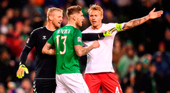 Denmark's Kasper Schmeichel and Simon Kjær confront Jeff Hendrick after an early incident in last night's game at the Aviva Stadium. Photo: Stephen McCarthy/Sportsfile