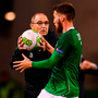 Republic of Ireland manager Martin O'Neill gives the ball to Matt Doherty for a throw-in. Photo : Stephen McCarthy/Sportsfile