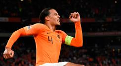 Virgil van Dijk celebrates after scoring the opening goal during last night's Nations League match between Netherlands and Germany in Amsterdam. Photo: John Thys/Getty