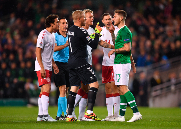 13 October 2018; Kasper Schmeichel of Denmark confronts Jeff Hendrick of Republic of Ireland during the UEFA Nations League B group four match between Republic of Ireland and Denmark at the Aviva Stadium in Dublin. Photo by Ramsey Cardy/Sportsfile