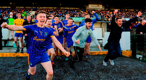 Clann na Gael players celebrate victory after the final whistle of the Roscommon SFC final. Photo: Barry Cregg/Sportsfile