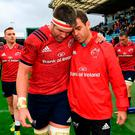 Billy Holland with Munster coach Johann van Graan after the game. Photo: Brendan Moran/Sportsfile