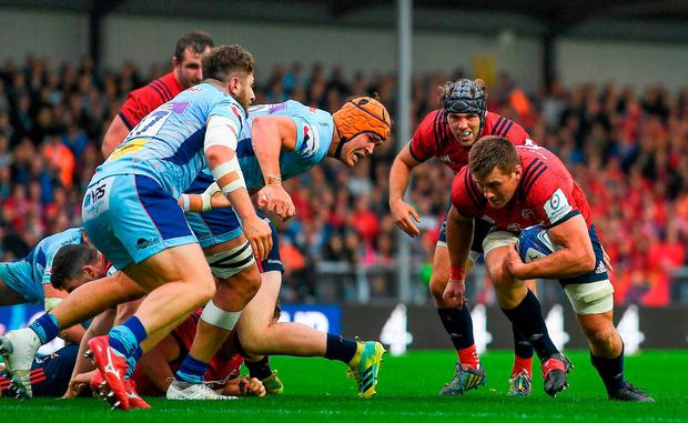 Supported by team-mate Duncan Williams, CJ Stander goes over to score Munster's second-half try. Photo: Brendan Moran/Sportsfile