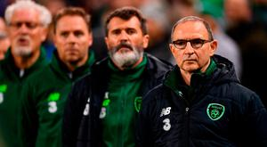 Ireland manager Martin O'Neill at the head of his management team prior to Ireland's draw against Denmark on Saturday. Photo: Ramsey Cardy/Sportsfile