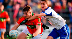 JT Moorehouse of Rathnew in action against Ciaran McGettigan of St Patrick's. Photo: Sam Barnes/Sportsfile