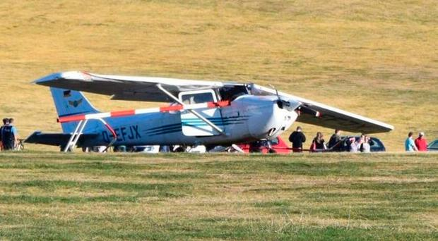 Three onlookers dead after small plane rolls into waiting crowd