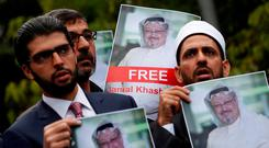 Missing: Friends of journalist Jamal Khashoggi hold his pictures during a protest outside the Saudi Consulate in London. Photo: Reuters