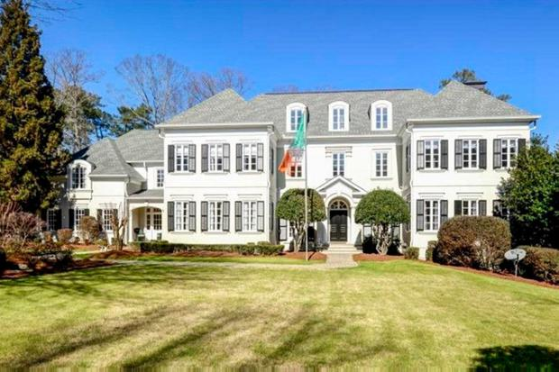 Opulence: Former Dragon's Den star Peter Casey has sold his 11,000sq ft mansion in Atlanta, which included a swimming pool, wine cellar, cinema room, and putting green.