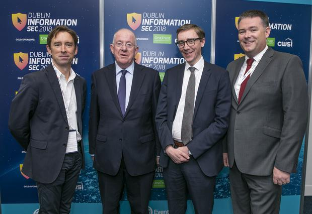 MInister for Justice Charlie Flanagan TD pictured with INM Group Managing Editor Ed Mc Cann, INM's Technology Editor Adrian Weckler and Michael Gubbins of the Garda Cyber Crime Bureau at the opening of the 2018 Information Sec in the RDS