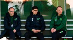 Callum O'Dowda watches on during a Republic of Ireland training session in the company of manager Martin O'Neill, left, and physiotherapist Ciaran Murray, right, at the FAI National Training Centre in Abbotstown, Dublin. Photo by Stephen McCarthy/Sportsfile